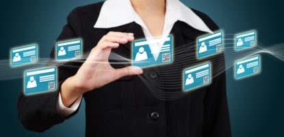 business woman holding a virtual card